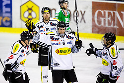 3.01.2014, Hala Tivoli, Ljubljana, SLO, EBEL, HDD Telemach Olimpija Ljubljana vs Dornbirner Eishockey Club, 63rd Game Day, in picture Jonathan D'Aversa (Dornbirner Eishockey Club, #6) celebrates with teammates after scoring a goal during the Erste Bank Icehockey League 63rd Game Day match between HDD Telemach Olimpija Ljubljana and Dornbirner Eishockey Club at the Hala Tivoli, Ljubljana, Slovenia on 2014/01/03. (Photo By Matic Klansek Velej / Sportida)