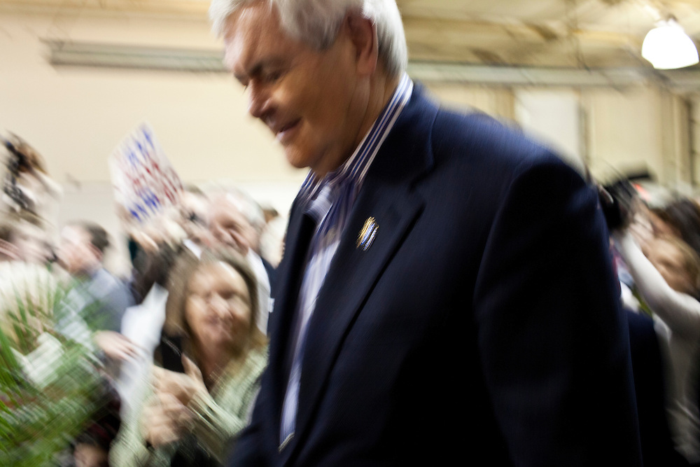 Republican presidential candidate Newt Gingrich arrives for a rally at his campaign office on Monday, January 2, 2012 in Davenport, IA.