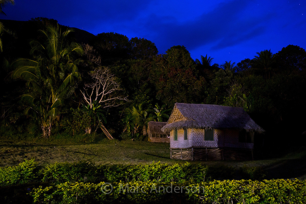 Small village house at night, Erap Valley, Papua New Guinea