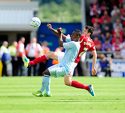 Bristol City's Brendan Moloney clears the ball from Coventry City's Franck Moussa  - Photo mandatory by-line: Dougie Allward/JMP - Tel: Mobile: 07966 386802 11/08/2013 - SPORT - FOOTBALL - Sixfields Stadium - Sixfields Stadium -  Coventry V Bristol City - Sky Bet League One