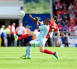 Bristol City's Brendan Moloney clears the ball from Coventry City's Franck Moussa  - Photo mandatory by-line: Dougie Allward/JMP - Tel: Mobile: 07966 386802 11/08/2013 - SPORT - FOOTBALL - Sixfields Stadium - Sixfields Stadium -  Coventry V Bristol City - Sky Bet League One