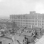 Studebaker buildings #53 and #58 are shown in this c. 1910 image.  This shot was taken from the roof of another Studebaker factory building facing southwest.  These buildings were later home to Standard Surplus and the Newman and Altman Studebaker parts business.