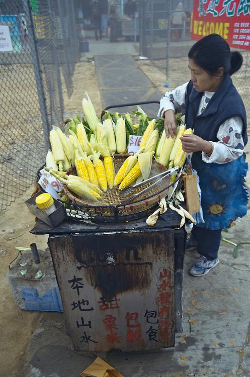 Vendor selling corn on the cob outside Po Lin Buddhist monastery, Lantau Island, Hong Kong