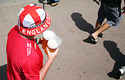 England fans carrying pints of beer