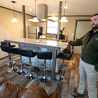 Tombigbee State Park Manager Jeff Rosamond, stands in cabin 3 that has been renovated.