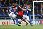 Nathaniel Mendez-Laing and Jamie Allen challenge Kyel Reid during the EFL Sky Bet League 1 match between Rochdale and Coventry City at Spotland, Rochdale, England on 17 April 2017. Photo by Daniel Youngs.