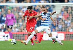 Liverpool's Emre Can is challenged by Queens Park Rangers's Sandro - Photo mandatory by-line: Dougie Allward/JMP - Mobile: 07966 386802 - 19/10/2014 - SPORT - football - London - Loftus Road - QPR v Liverpool - Barclays Premier League