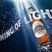 Bottle of Magners Light submerged underwater Ray Massey is an established, award winning, UK professional  photographer, shooting creative advertising and editorial images from his stunning studio in a converted church in Camden Town, London NW1. Ray Massey specialises in drinks and liquids, still life and hands, product, gymnastics, special effects (sfx) and location photography. He is particularly known for dynamic high speed action shots of pours, bubbles, splashes and explosions in beers, champagnes, sodas, cocktails and beverages of all descriptions, as well as perfumes, paint, ink, water – even ice! Ray Massey works throughout the world with advertising agencies, designers, design groups, PR companies and directly with clients. He regularly manages the entire creative process, including post-production composition, manipulation and retouching, working with his team of retouchers to produce final images ready for publication.