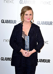 Amy Poehler with the Inspiration Award in the press room at the Glamour Women of the Year Awards 2017, Berkeley Square Gardens, London.