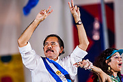 "10 JANUARY 2007 - MANAGUA, NICARAGUA:  DANIEL ORTEGA, newly inaugurated president of Nicaragua, and his wife, ROSARIO MURILLO, wave to the crowd in Plaza de Fe during his inaugural speech. Ortega, the leader of the Sandanista Front, was sworn in as the President of Nicaragua Wednesday. Ortega and the Sandanistas ruled Nicaragua from their victory of ""Tacho"" Somoza in 1979 until their defeat by Violetta Chamorro in the 1990 election.  Photo by Jack Kurtz"