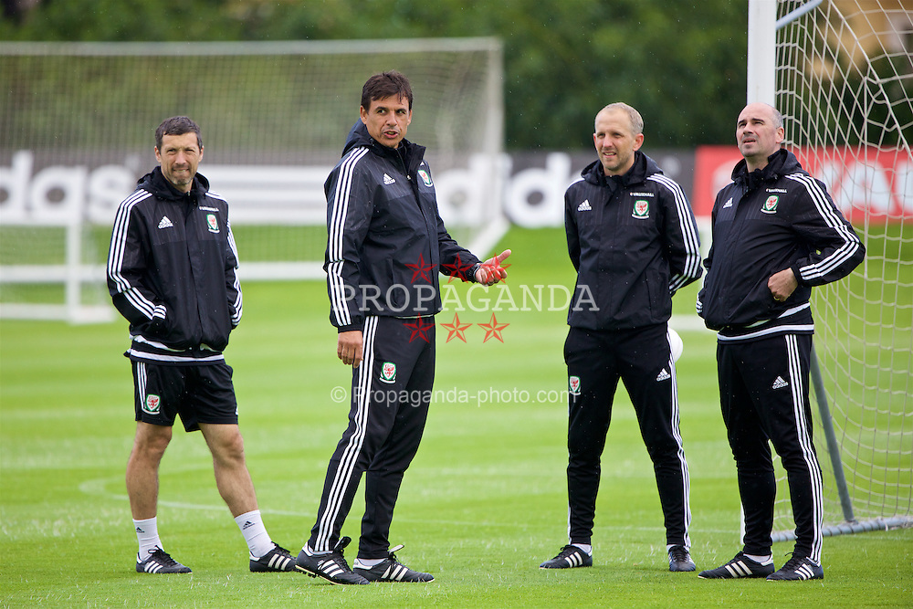 VALE DO LOBO, PORTUGAL - Saturday, May 28, 2016: Wales' manager Chris Coleman with his staff [L-R] head performance Ryland Morgans, coach Paul Trollope and sport psychologist Ian Mitchall during day five of the pre-UEFA Euro 2016 training camp at the Vale Do Lobo resort in Portugal. (Pic by David Rawcliffe/Propaganda)
