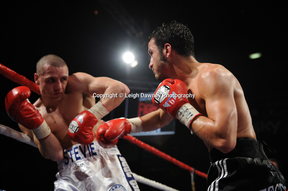 Ermano Fegatilli (black,white & red shorts) defeats Stephen Foster Jnr claiming the European Super Featherweight Title after 12 x 3min rounds. Venue: The Night of Champions, Premier Suite,Reebok Stadium, Bolton,UK. Saturday 26th February 2011. Hatton Promotions. Photo credit © Leigh Dawney.