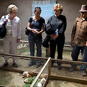 The CARE Learning Tour group visits a guinea pig farm in the village of Neque, near Ayacucho, where CARE is working to support community association groups...Women in the community have said that when they first joined the group their husbands didn't take much notice. Now they are working with their husbands to discuss loans and business plans and ways to help their families. The group meets monthly and provides support to each other both financially and by sharing their experiences with their individual businesses. ..Increasing access to financial services for the poor must be part of an integrated and holistic approach to community empowerment in order to effectively address maternal health. Such an approach acknowledges the deep inequities that shape health seeking behaviors and would marry supply and demand by strengthening health systems and service delivery on the one hand while building community pressure for quality care on the other. ..