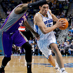 February 2, 2012; New Orleans, LA, USA; New Orleans Hornets power forward Gustavo Ayon (15) drives in against Phoenix Suns power forward Hakim Warrick (21) during the first quarter of a game at the New Orleans Arena.   Mandatory Credit: Derick E. Hingle-US PRESSWIRE