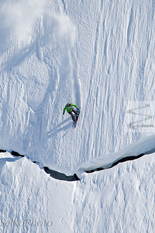 Two time Olympic Snowboarder Cross Gold Medalist Seth Wescott Riding Steep Powder in the Chugach Mountains with Points North Heli Skiing based out of Cordova, AK on April 16, 2011.