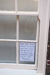 Sign on house window requesting passer-bys not to stroke their cat during the Coronavirus pandemic lock down, Norwich UK March 2020