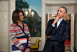 "President Barack Obama and First Lady Michelle Obama participate in a ""Let's Move!"" #GimmeFive Campaign video taping in the Diplomatic Reception Room of the White House, Feb. 20, 2015. (Official White House Photo by Amanda Lucidon)<br /> <br /> This official White House photograph is being made available only for publication by news organizations and/or for personal use printing by the subject(s) of the photograph. The photograph may not be manipulated in any way and may not be used in commercial or political materials, advertisements, emails, products, promotions that in any way suggests approval or endorsement of the President, the First Family, or the White House."