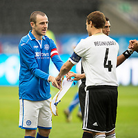 Rosenborg v St Johnstone....18.07.13  UEFA Europa League Qualifier.<br /> Dave Mackay exchanges pennants with Tore Reginiussen<br /> Picture by Graeme Hart.<br /> Copyright Perthshire Picture Agency<br /> Tel: 01738 623350  Mobile: 07990 594431