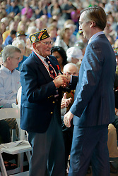 06 June 2014. The National WWII Museum, New Orleans, Lousiana. <br /> WWII veteran Pfc Warren Dufrene, 75th Division, 291st Infrantry is honored with the French Legion of Honor medal by French Consul General, Claude Brunet..<br /> Photo; Charlie Varley/varleypix.com