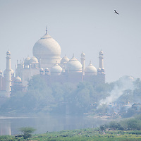 Feb 12, 2013 - The Taj Mahal seen across the River Yamuna through the smog in Agra, India. To cut back on pollution, cars and buses are not allowed to drive to the Taj Mahal but to a parking lot about 1.5 miles away, where visitors can take battery-run buses or horse-drawn carriages to reach the monument.<br /> <br /> Story Summary: It is said that the battle over global warming is to be won or lost in Asia. With growing populations and new economic boom in the global markets across Asia countries like India, Nepal and Cambodia have to grapple with the success and the environmental disaster that comes with ramped up production in unchecked or unregulated industries to compete in todays marketplace. The catastrophic air pollution makes for new problems to be dealt with such as a future health crisis, quality of life issues and the tarnished image of reduced visibility to world heritage sites for tourism.