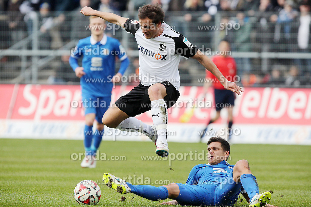 15.03.2015, Hardtwald, Sandhausen, GER, 2. FBL, SV 1916 Sandhausen vs Eintracht Braunschweig, 25. Runde, im Bild Manuel Stiefler (SV Sandhausen) im Zweikampf mit Mirko Boland (Eintracht Braunschweig) // during the 2nd German Bundesliga 25th round match between SV 1916 Sandhausen and Eintracht Braunschweig at the Hardtwald in Sandhausen, Germany on 2015/03/15. EXPA Pictures &copy; 2015, PhotoCredit: EXPA/ Eibner-Pressefoto/ Bermel<br /> <br /> *****ATTENTION - OUT of GER*****