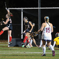 TOM KELLY IV &mdash; DAILY TIMES<br /> Carroll's Grace McClatchy (20) celebrates her second goal of the game with her teammates Keara McNulty (7) and Alyssa Lemons (32) as O'Hara goalkeeper Maureen Henegan (75) looks on during the Philadelphia Catholic League Championship Field Hockey match between Archbishop Carroll and Cardinal O'Hara which was held Thursday night October 30, 2014 at Neumann University.