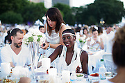 NEW YORK - AUGUST 25, 2014: Attendees gathered for the Diner en Blanc event in Battery Park City. Fashionable New Yorkers dressed in all white and brought food, furniture and decor to the open field for the impromptu dinner and dance party. CREDIT: Clay Williams for Gothamist.<br /> <br /> &copy; Clay Williams / http://claywilliamsphoto.com