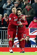 Goalscorers Liverpool striker Mohamed Salah (11) and Liverpool striker Roberto Firmino (9) during the Premier League match between Liverpool and Arsenal at Anfield, Liverpool, England on 29 December 2018.