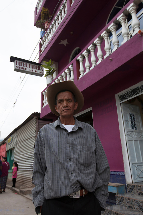Andres Miguel Tomas, 68, stands outside his Hotel Florida, named after the US state where he lived and worked for many years before returning to his native San Miguel Acatán, highland town made up mostly of Akatek Mayans. San Miguel Acatán, Huehuetenango, Guatemala. November 2, 2012.