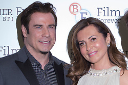 © licensed to London News Pictures. London, UK 25/06/2013. John Travolta (left) and Ella Krasner attending to the screening of 'Killing Season' to support The Krasner Fund for the BFI Collections at BFI London on Tuesday, 25 June 2013. Photo credit: Tolga Akmen/LNP