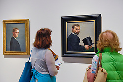 "© Licensed to London News Pictures. 27/06/2019. LONDON, UK. Visitors view (L) ""Self-portrait at the Age of Twenty (Autoportrait à l'âge de vingt ans)"", 1885, and (R) ""Félix Jasinki Holding His Hat (Félix Jasinki tenant son chapeau)"", 1887, both by Félix Vallotton. Preview of ""Félix Vallotton:  Painter of Disquiet"", an exhibition of paintings and prints Swiss artist Félix Vallotton at the Royal Academy of Arts.  Around 100 works are on show 30 June to 29 September 2019.   Photo credit: Stephen Chung/LNP"