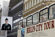 GERMANY - BERLIN - A tourbus with tourists passing Checkpoint Charlie.  PHOTO GERRIT DE HEUS