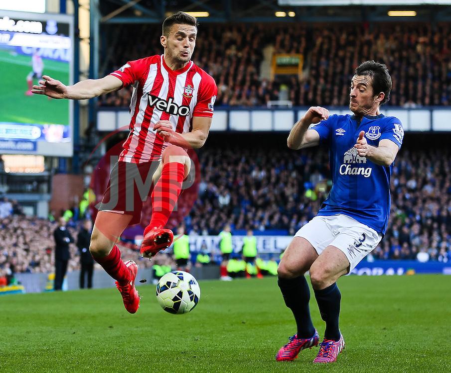 Southampton's Dusan Tadic in action with Everton's Leighton Baines - Photo mandatory by-line: Matt McNulty/JMP - Mobile: 07966 386802 - 04/04/2015 - SPORT - Football - Liverpool - Goodison Park - Everton v Southampton - Barclays Premier League