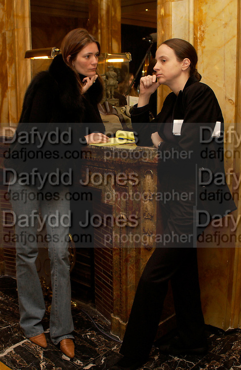 Plum Sykes and Alexandra Kotur, Getting ready before the  Thirteenth Annual Crillon Haute Couture Ball. Paris,  29 November 2003. © Copyright Photograph by Dafydd Jones 66 Stockwell Park Rd. London SW9 0DA Tel 020 7733 0108 www.dafjones.com