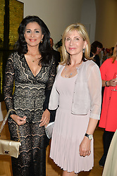 Left to right, LADY FORSYTH and KAREN PHILLIPS at a private view and auction of millinery organised by author, philanthropist and hat collector Eva Lanska in aid of Women for Women International held at Pace, Burlington Gardens, London on 10th June 2015.