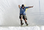 Warwick, New York - A skier wearing shorts and a cape crosses the water during the annual Spring Rally at Mount Peter Ski and Ride on March 21, 2010.