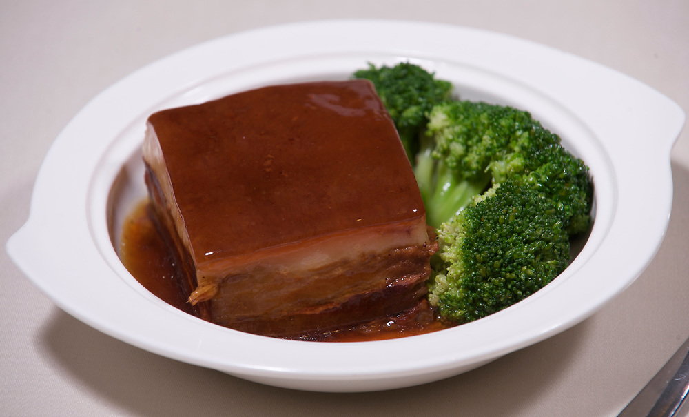 06 July 2009, Macau, China --- Braised Garoupa Fillet with Broccoli dish. Photo by Victor Fraile --- Image by © Victor Fraile