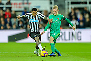Kenedy (#15) of Newcastle United challenges Will Hughes (#19) of Watford during the Premier League match between Newcastle United and Watford at St. James's Park, Newcastle, England on 3 November 2018.