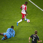 Nov 8, 2015; Harrison, NJ, USA; New York Red Bulls forward Bradley Wright-Phillips (99) passes D.C. United goalkeeper Bill Hamid (28)during the second half of the MLS Playoffs at Red Bull Arena. Mandatory Credit: William Hauser-USA TODAY Sports