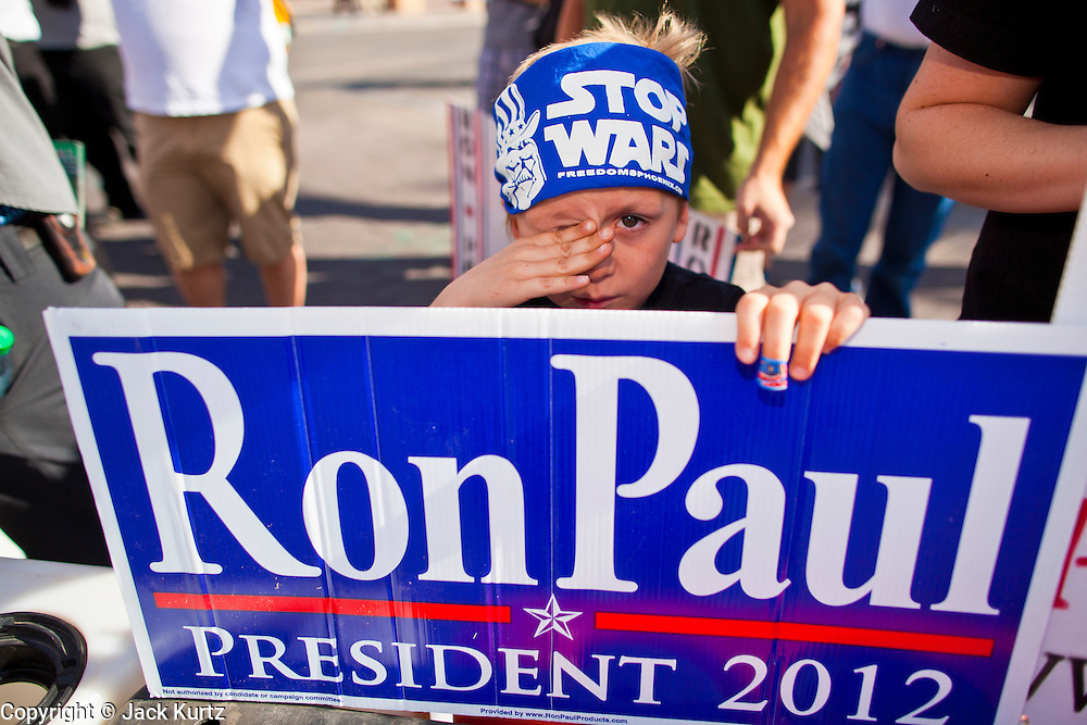 22 FEBRUARY 2012 - MESA, AZ: BRYSON POWER, 6, from Glendale, AZ, rallies in support of Congressman Ron Paul with a peace bandana on his head in Mesa Wednesday. Ron Paul supporters had hundreds of people in front of the Mesa Arts Center before CNN's Arizona Republican Presidential Debate Wednesday.     PHOTO BY JACK KURTZ