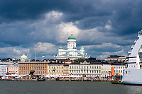 Finland, Helsinki. The Helsinki Cathedral and a cruise ship.