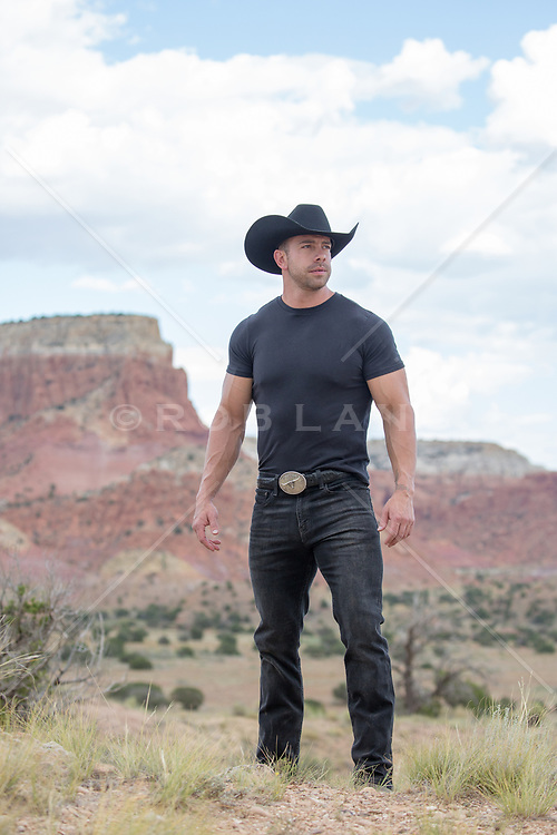 cowboy by a mountain range in The Southwest