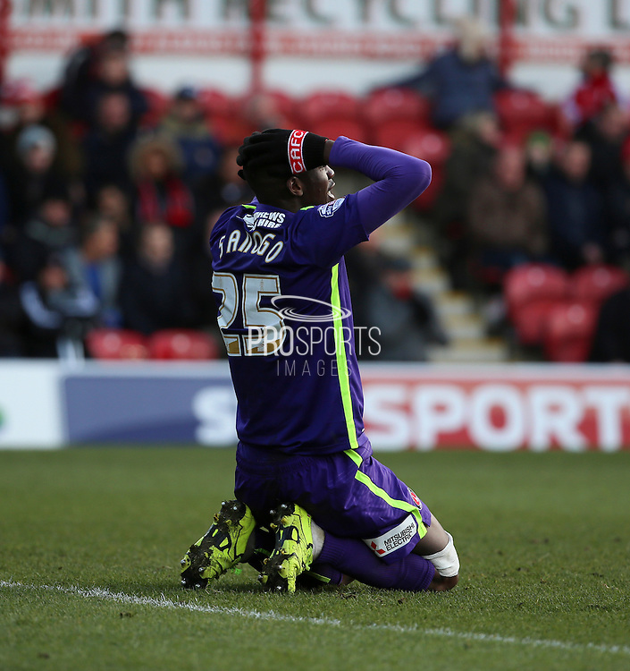 Charlton Athletic striker, Yaya Sanogo (25) on knees looking unhappy during the Sky Bet Championship match between Brentford and Charlton Athletic at Griffin Park, London, England on 5 March 2016. Photo by Matthew Redman.