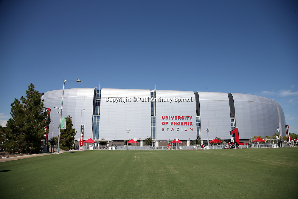 The University of Phoenix Stadium stands tall in this wide angle general view photograph taken from the Great Lawn tailgating grass area before the Arizona Cardinals 2015 NFL preseason football game against the Kansas City Chiefs on Saturday, Aug. 15, 2015 in Glendale, Ariz. The Chiefs won the game 34-19. (©Paul Anthony Spinelli)
