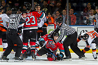KELOWNA, BC - NOVEMBER 8: Lineman Cody Wanner gets between Daniel Baker #4 of the Medicine Hat Tigers and Pavel Novak #11 of the Kelowna Rockets during second period at Prospera Place on November 8, 2019 in Kelowna, Canada. (Photo by Marissa Baecker/Shoot the Breeze)