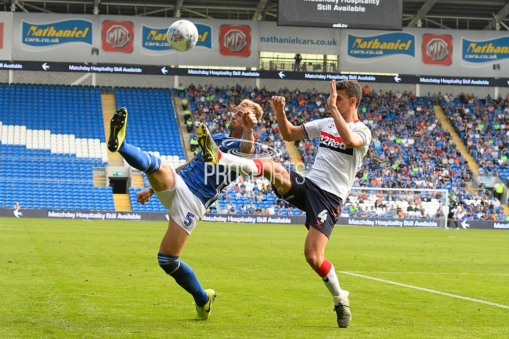 Aden Flint (5) of Cardiff City battles for possession with Daniel Ayala (4) of Middlesbrough during the EFL Sky Bet Championship match between Cardiff City and Middlesbrough at the Cardiff City Stadium, Cardiff, Wales on 21 September 2019.