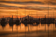 Sunrise in Portland, Oregon, with Mt. Hood and a marina on the Columbia River.