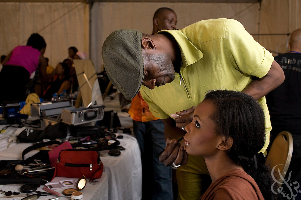 """Nigerian makeup artists and hair dressers work to prepare models for the fashion portion of the ThisDay festival July 13, 2008 in Lagos, Nigeria. The festival, themed """"Africa Rising"""", aims to raise awareness of African issues while promoting positive images of Africa using music, fashion and culture in a series of concerts and events in Nigeria, the United States and the United Kingdom. ."""