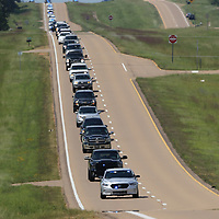 The funeral procession for former Lafayette County Sheriff Buddy East makes it's way along Hwy 6 to the gravesite Friday afternoon.
