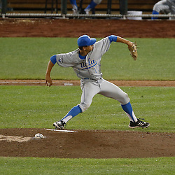 Jun 24, 2013; Omaha, NE, USA; UCLA Bruins pitcher James Kaprielian (11) delivers a pitch during the seventh inning in game 1 of the College World Series finals against the Mississippi State Bulldogs at TD Ameritrade Park. Mandatory Credit: Derick E. Hingle-USA TODAY Sports